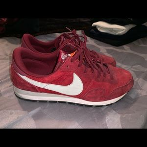 Men's size 14 red Nike sneakers